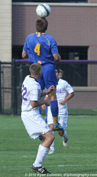 St Scholastica's Greg Doornink (4) heads the ball over St Thomas' Mike Hutton (22) on Sept. 21.